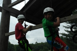 My son climbing at camp this summer
