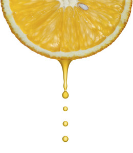 Drops of juice falling of the succulent orange