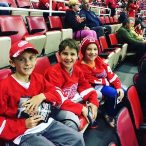 Gabe, Ari and Shaya in their Red Wings gear, ready for what turned out to be a great game!