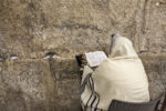 Jerusalem, Israel - July 16, 2015: Prayer at Western Wall on Tisha B'Av - annual fast day in Judaism, commemorates anniversary of destruction of the First and Second Temples in Jerusalem.