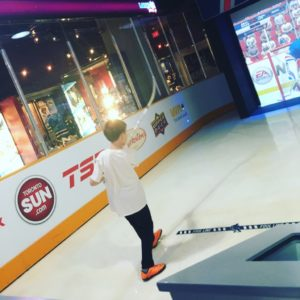 Putting all his might into shooting the puck at the Hockey Hall of Fame. It's harder than it looks.