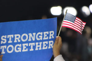 Stronger Together banner and USA Flag at a Hillary rally