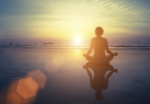 Yoga, fitness and healthy lifestyle. Silhouette meditation girl