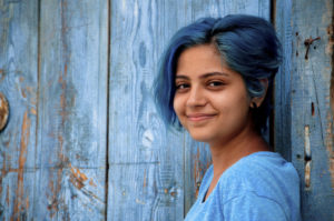 bluehaired-young-girl-smiles-000074136125_Medium