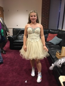 In her party dress and painted Converse high tops