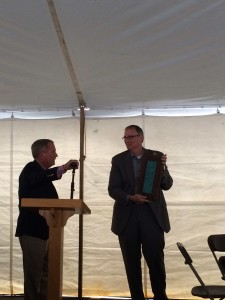 Mark Stutrud, receiving a farewell gift from Pewabic pottery